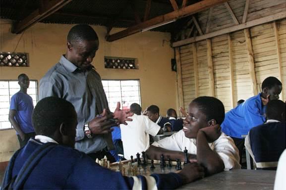 Robert Katende and Phiona Mutesi at Robert's chess program. Photo Credit - Walt Disney Studios